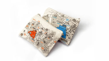 Two wallets in white, with a blue and an orange illustration of the map of Athens, in a white background
